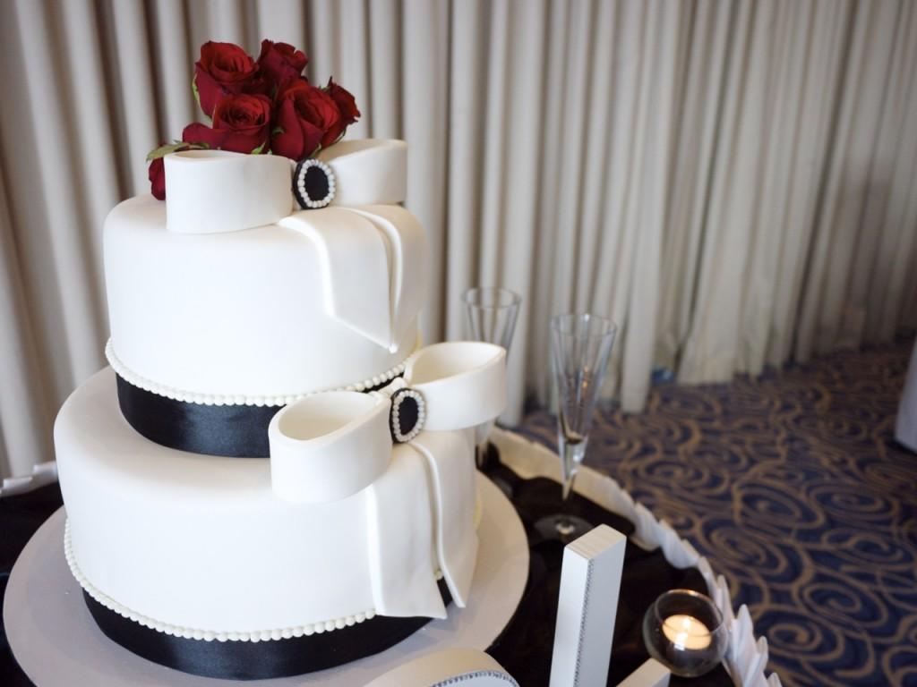 wedding styling - three tier cake with red roses