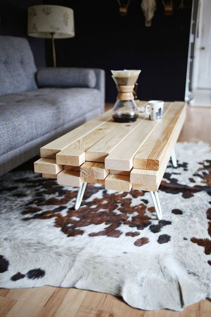 coffee table made of timber planks on cowhide rug