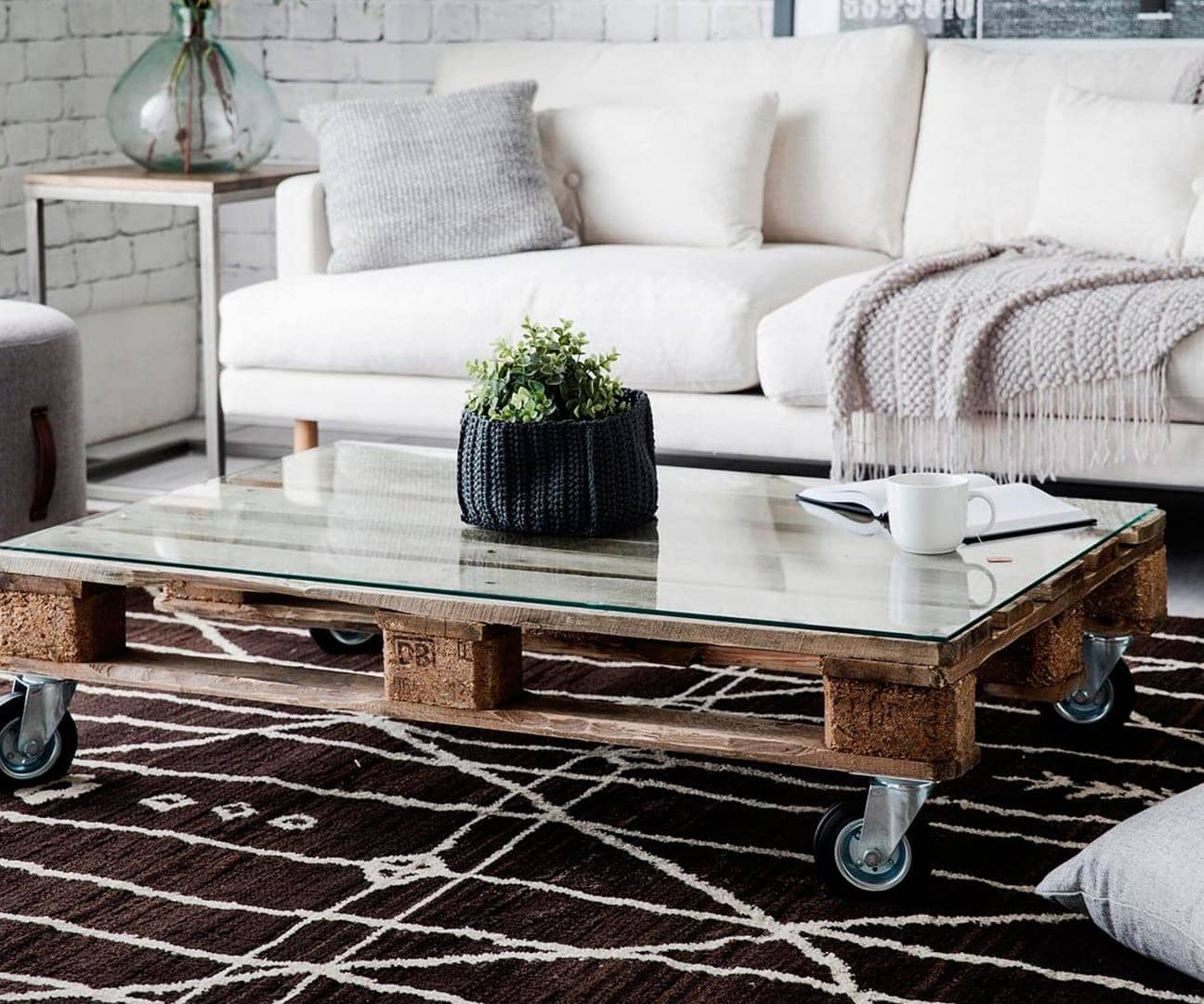 pallet coffee table with castor wheels and glass on top