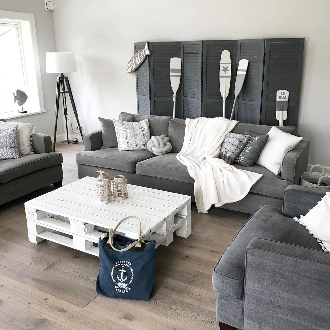 white painted pallet coffee table in coastal living room with grey sofa