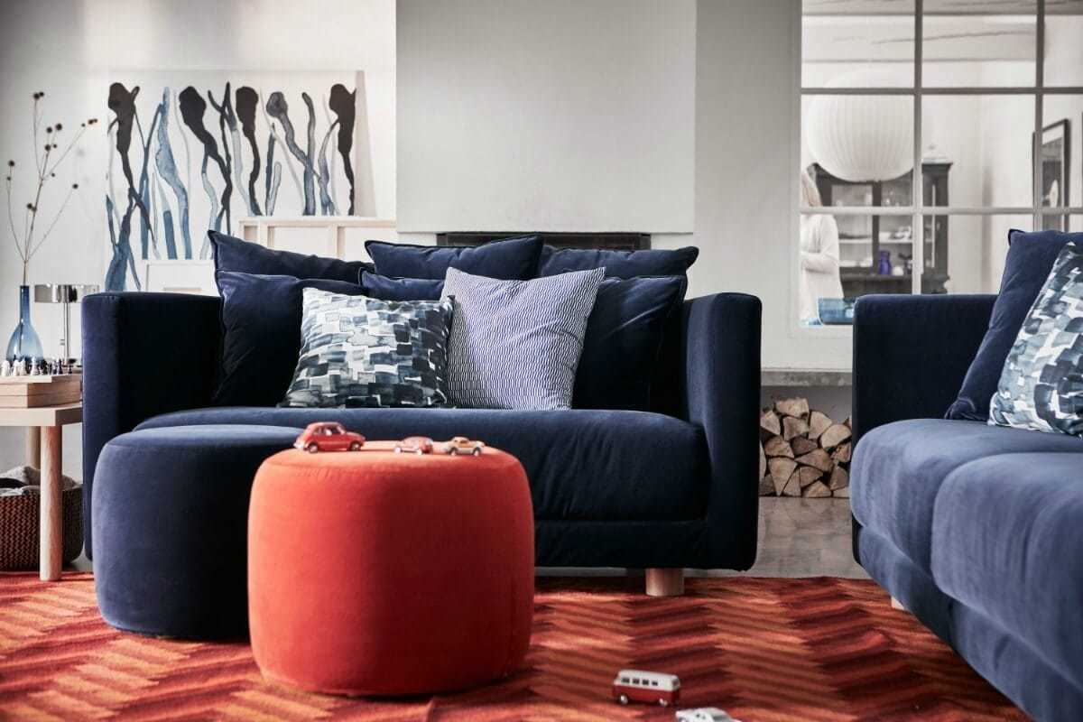 ikea PS 2017 blue sofa and red round ottoman in living room