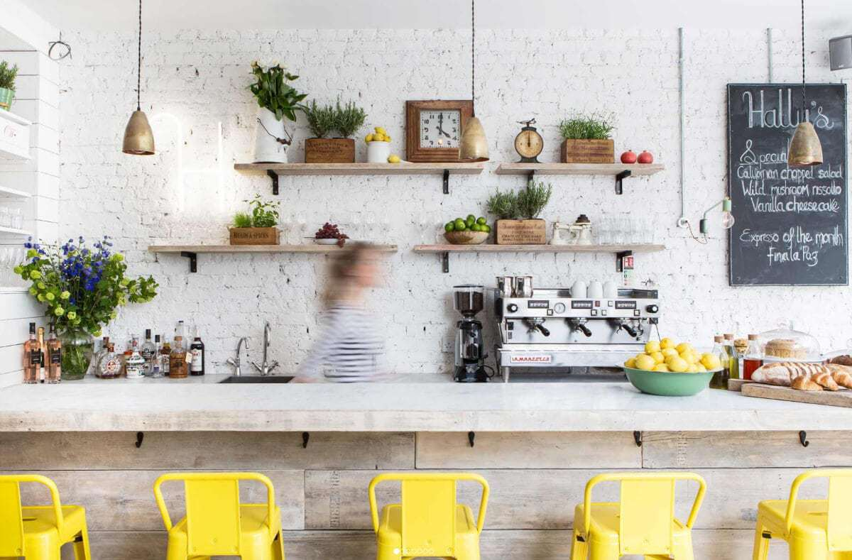 Industrial design ideas yellow stools and exposed white brick wall