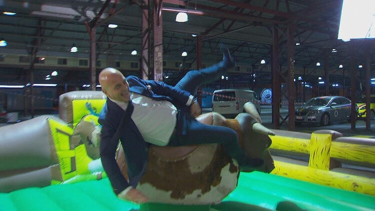 Neale Whitaker riding a mechanical bull on The BLock 2014