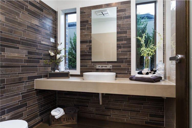 Horizontal brown feature tiles in Bathroom - Metricon Homes