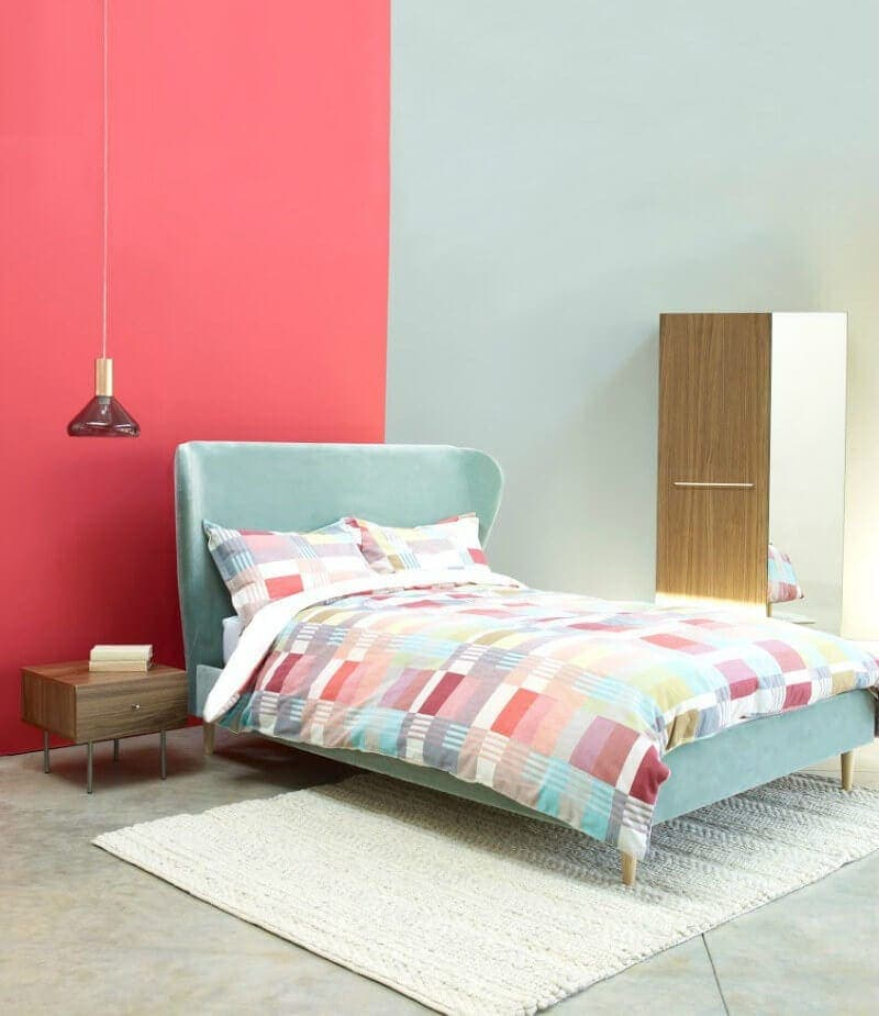 Pink Bedroom wall with soft teal and bluer tones from Habitat