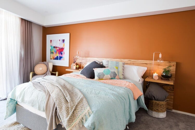 The Blocktagon bedroom and ensuite reveals Whitney and Andy master bedroom orange wall
