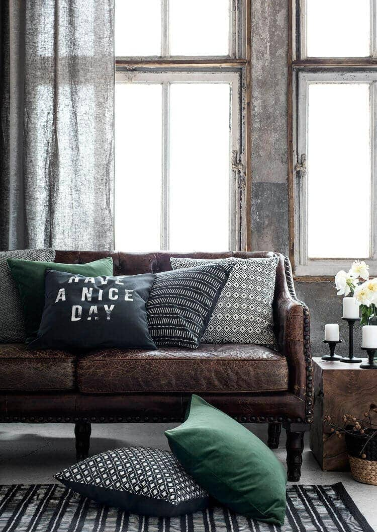 Aged Leather Sofa with Green Cushions on The Life Creative