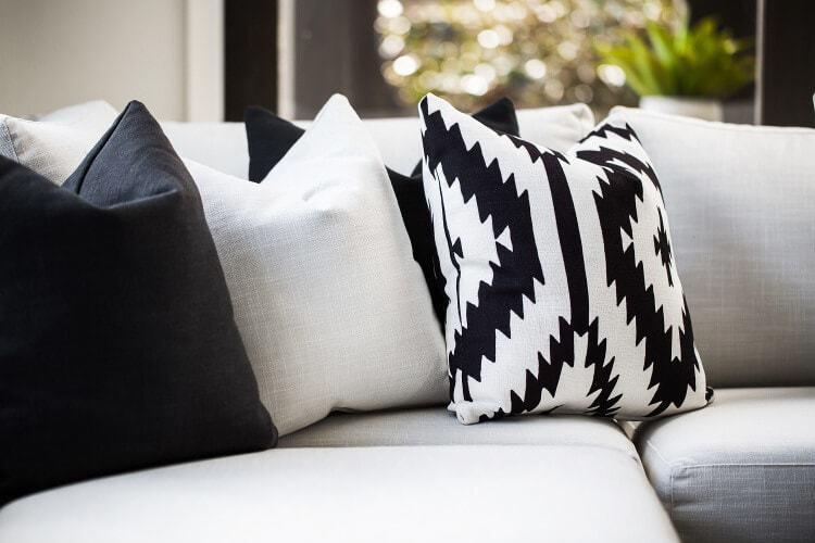 Living Room Design Ideas Monochromatic Cushions on Grey Sofa