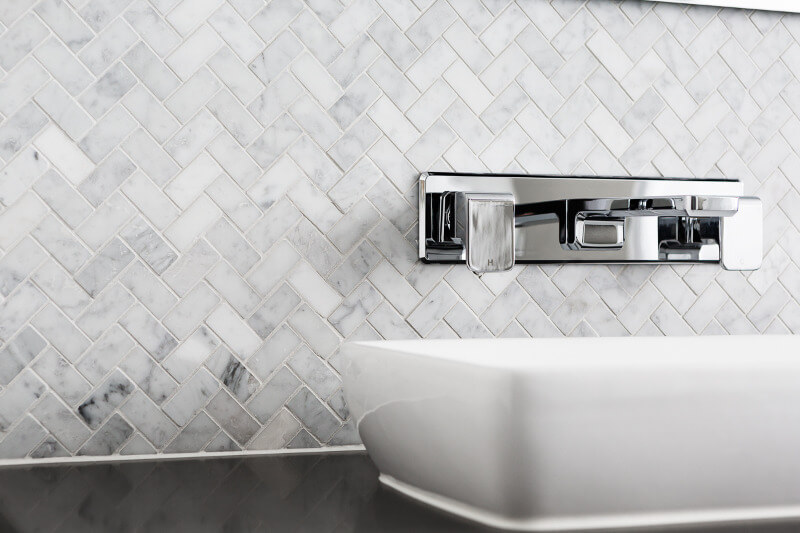Marble herringbone tiles in bathroom on The Life Creative