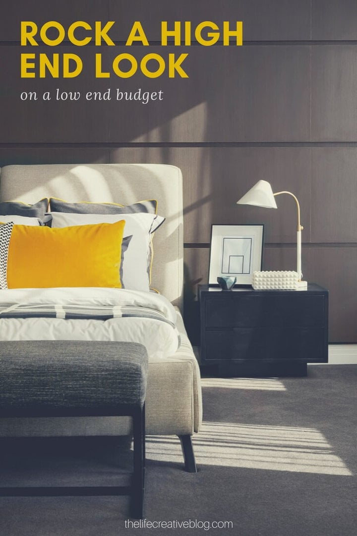 masculine bedroom with mustard velvet cushion and timber wall panels