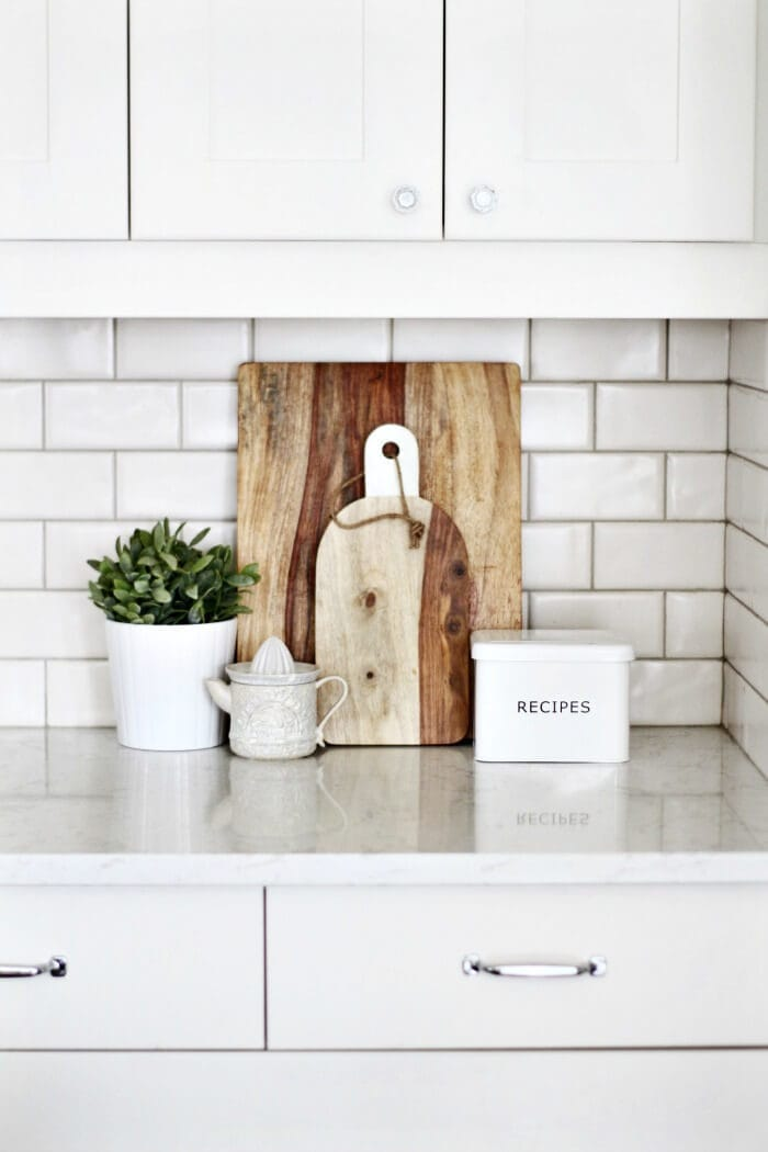 Kitchen vignette on TLC Interiors rustic breadboard and recipes tin