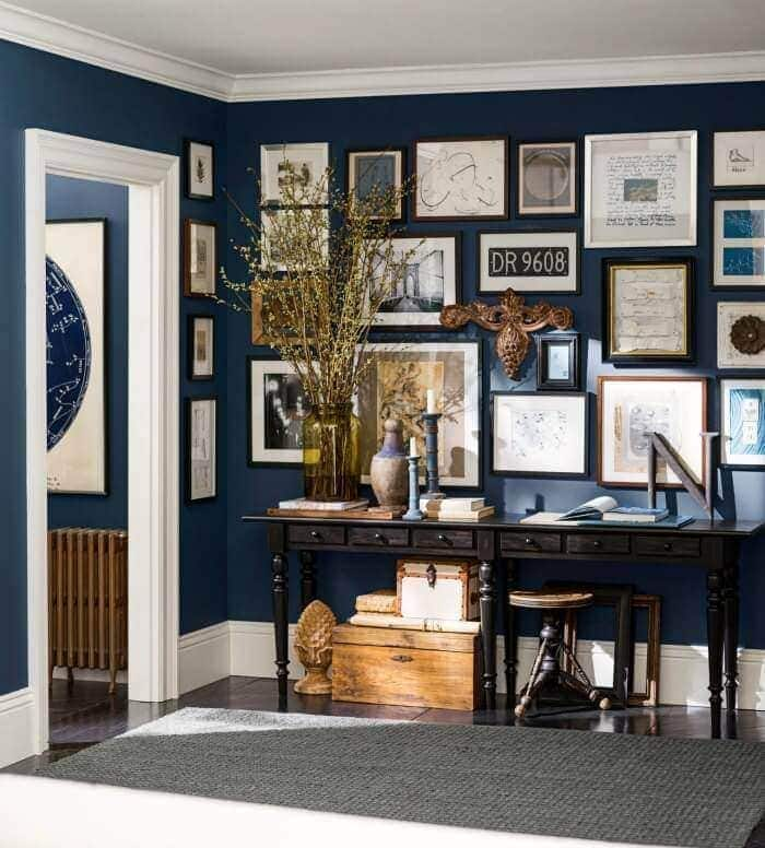Gallery wall ideas dark blue feature wall from Pottery Barn on The Life Creative