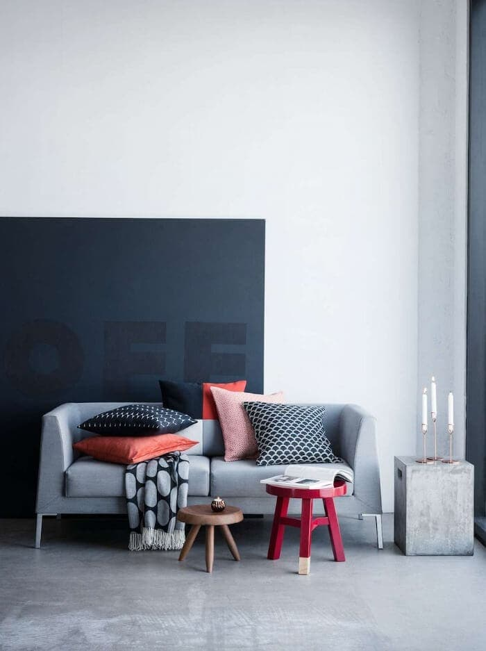 Grey sofa with orange and red cushions from H&M on The Life Creative