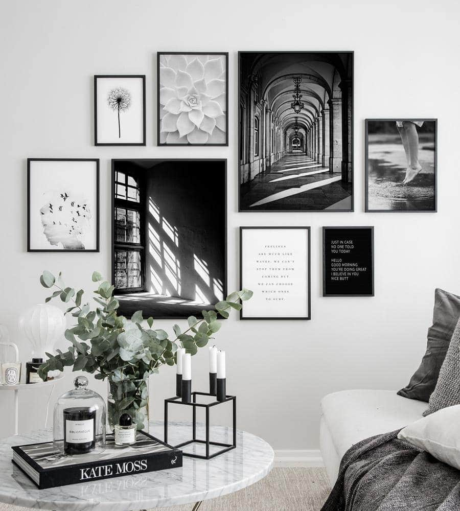 black and white gallery wall ideas in living room with marble coffee table
