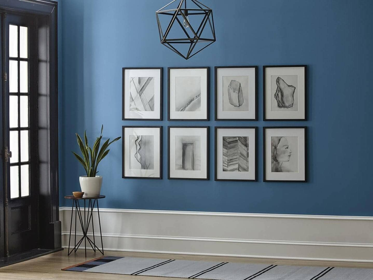 gallery wall ideas framed black and white photos on blue wall