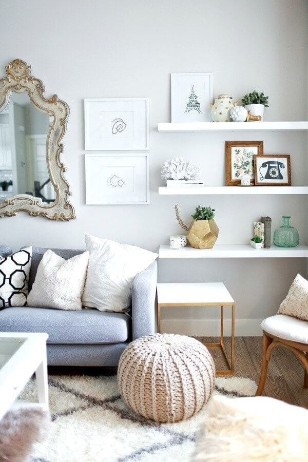 How to Style Shelves long white shelf with feminine vignettes The Life Creative