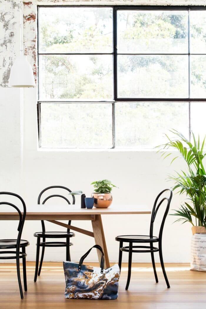 Squeak Design winter 2016 metallic marble bag in dining room black thonet chair