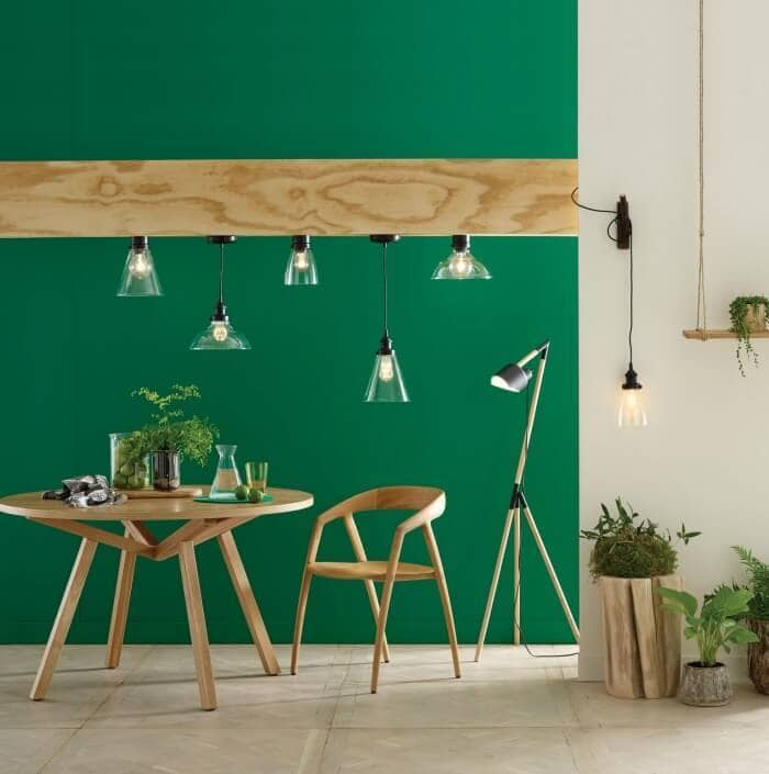 industrial pendant lights and green feature wall The Life Creative