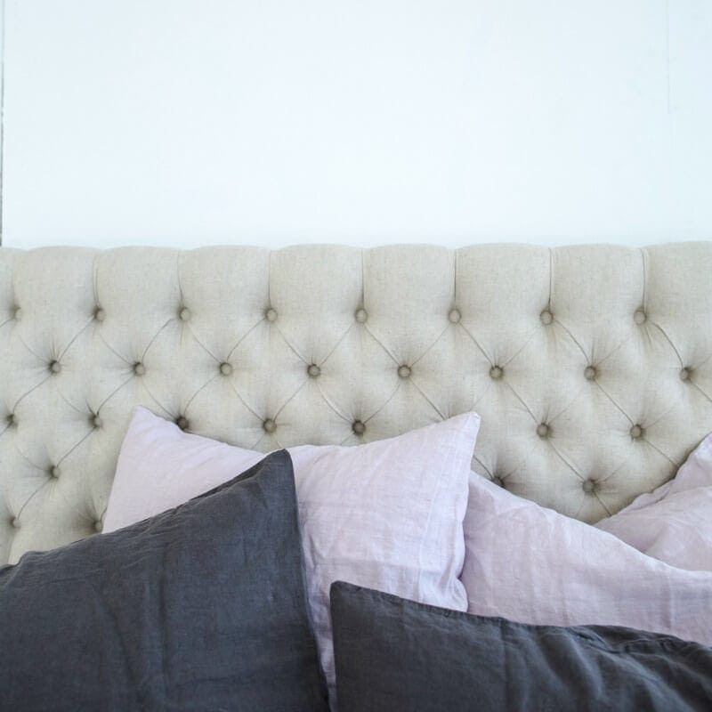 Bloom and Co cosy bedroom ideas upholstered tufted headboard with linen bedding from Bloom and Co
