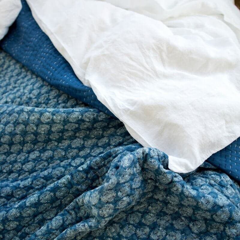 Blue and White Coverlet moroccan inspired from Bloom and Co cosy bedroom