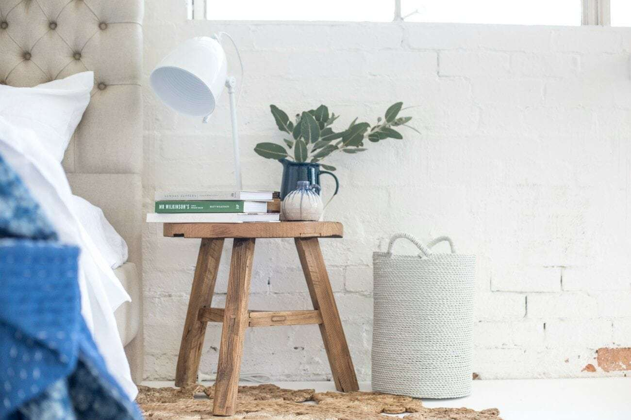 Cosy bedroom Wooden round side table from Bloom and Co