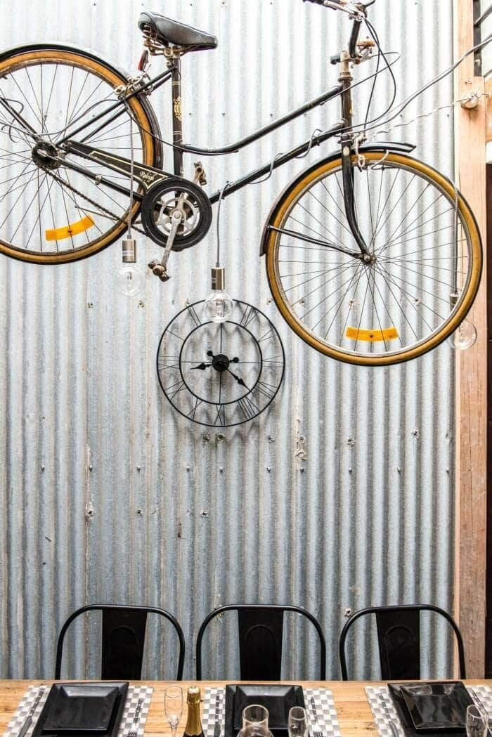 House Rules 2016 Clare and Hagan's Dining Room Bike on Corrugated Iron Feature Wall