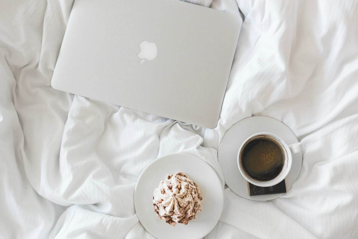 Laptop in bed with coffee and cake the life creative