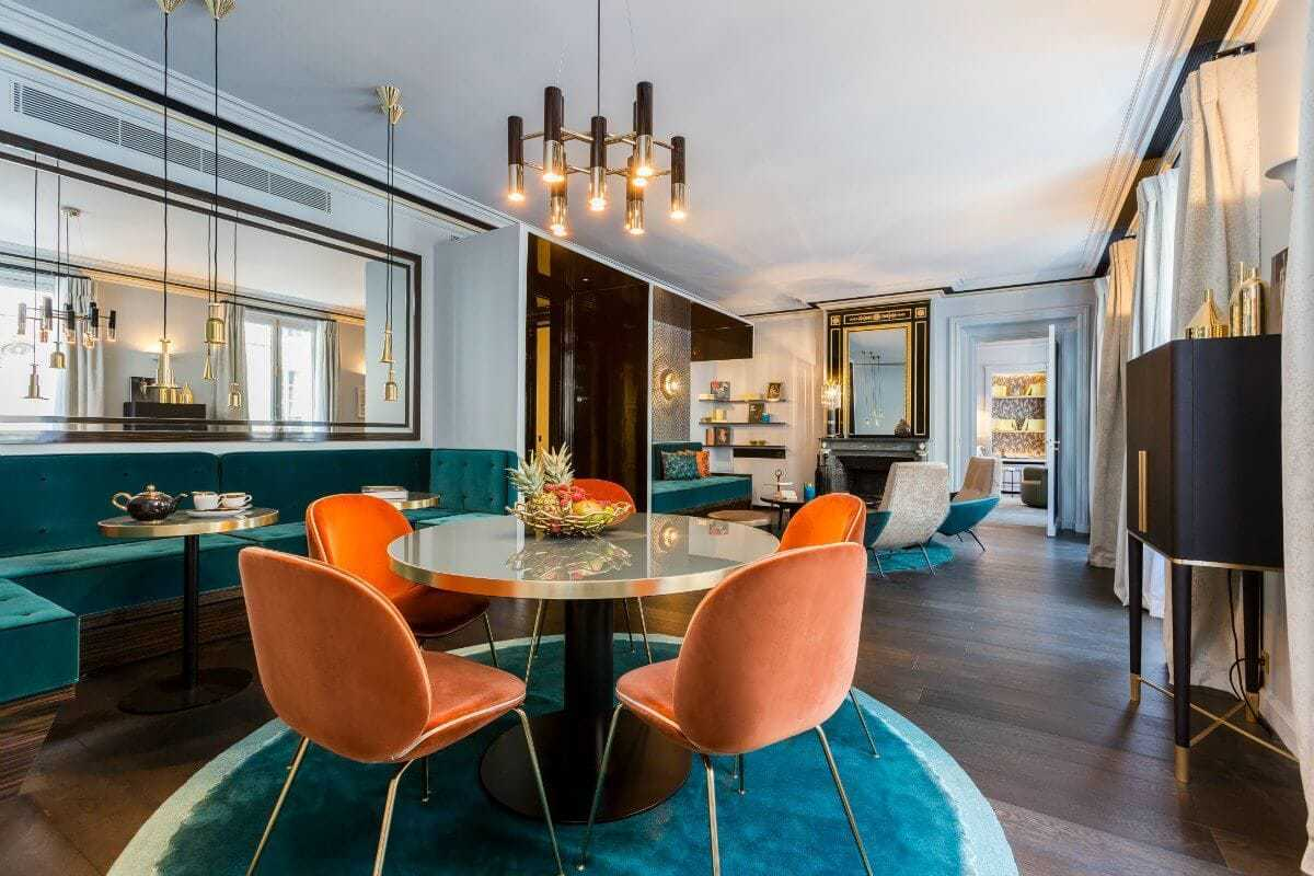 Parisian Design French Apartment with Orange and Teal Velvet