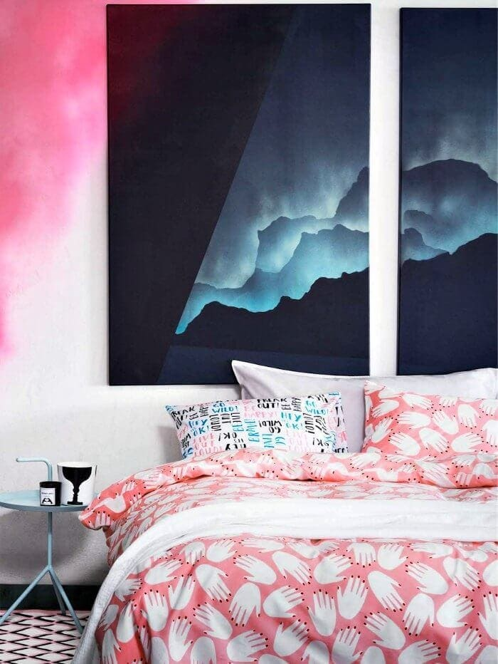 Pink and white hand bedding with masculine wall art from H&M