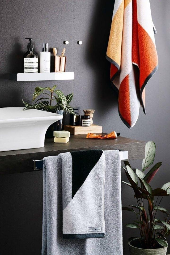 Sunday Minx Spice Bath Towel in dark bathroom walls The Life Creative