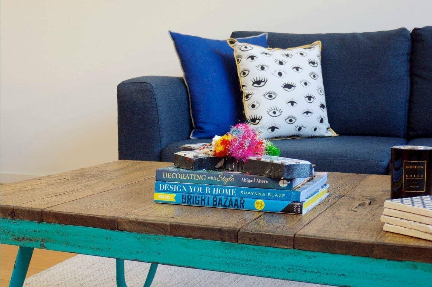 Blue sofa and teal industrial leg coffee table the life creative