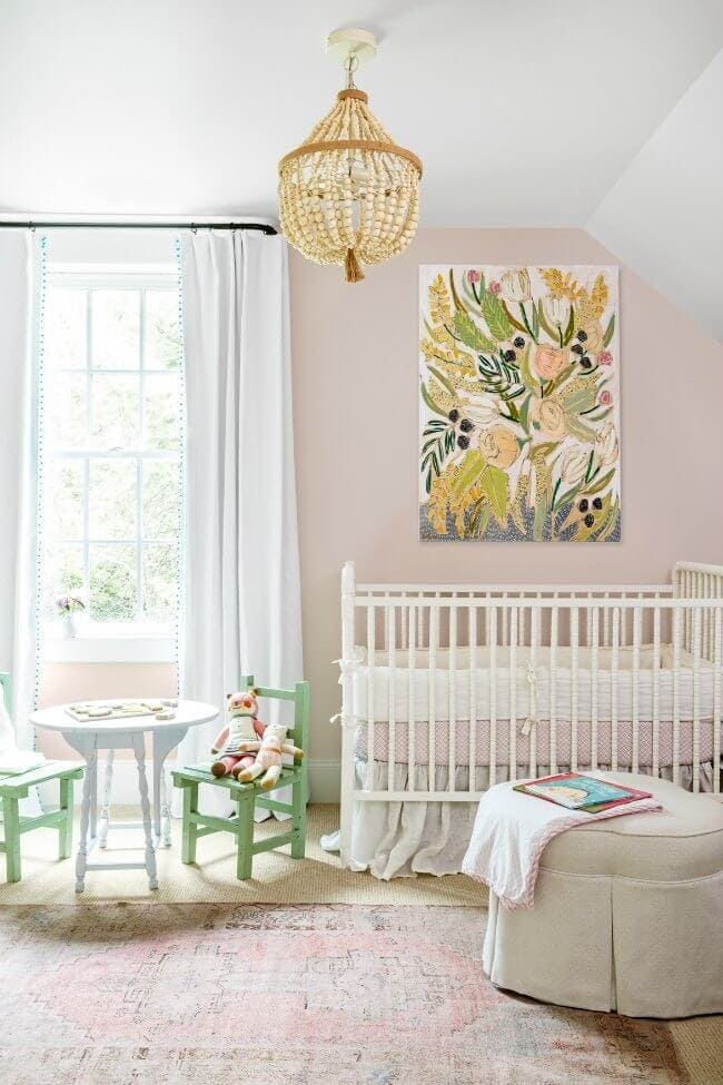 Feature art large wall art in baby girls nursery above cot