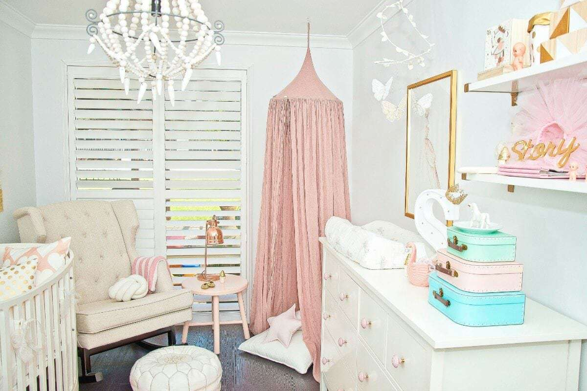Pink canopy in baby girls nursery nest design studio