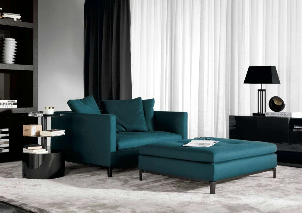 dark living room with dark teal sofa and ottoman the life creative
