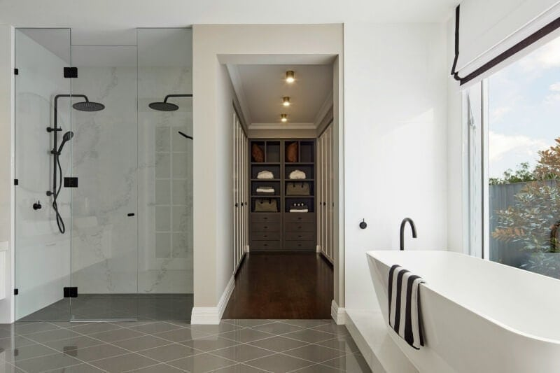 hamptons bathroom black shower head and marble tiles