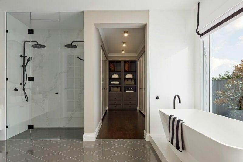 hamptons bathroom black shower head and marble tiles