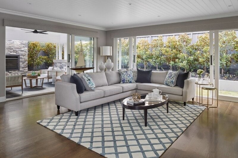 hamptons living room hamptons home with grey sectional sofa and blue and white rug
