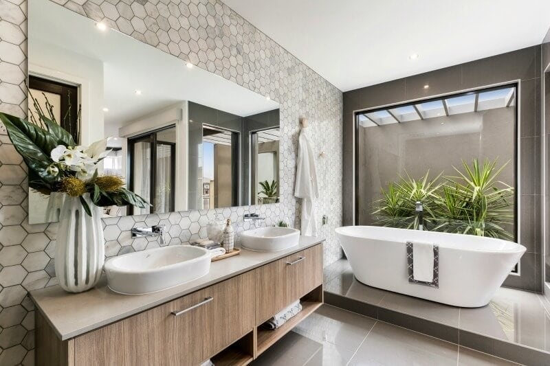 hexagonal marble tiles in master bathroom with freestanding bath tub