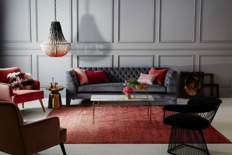 klaylife pendant light grey tufted sofa with red and coral cushions and red rug