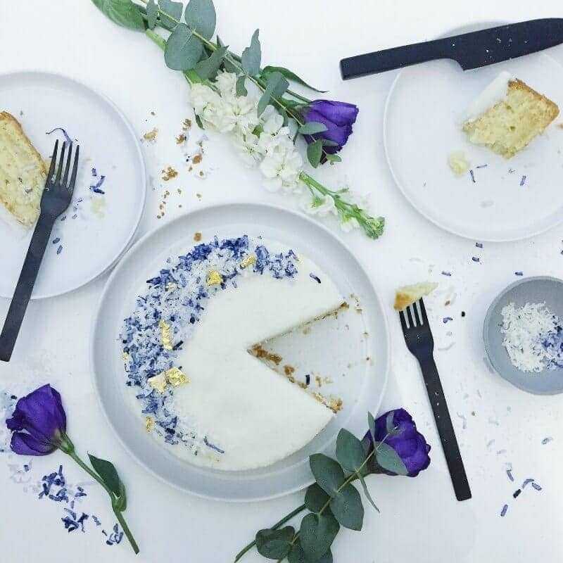 vegan cocont cake flatlay styling with black cutlery