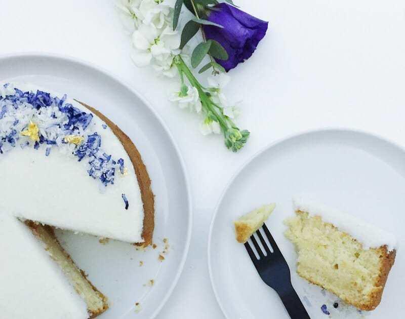 vegan coconut cake recipe with purple flower icing the life creative