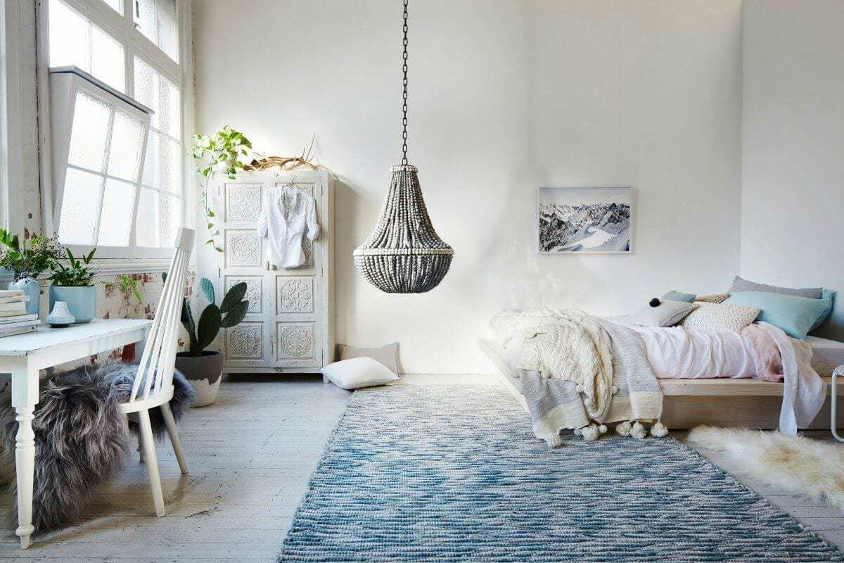 White bohemian bedroom with clay pendant light from klaylife on the life creative