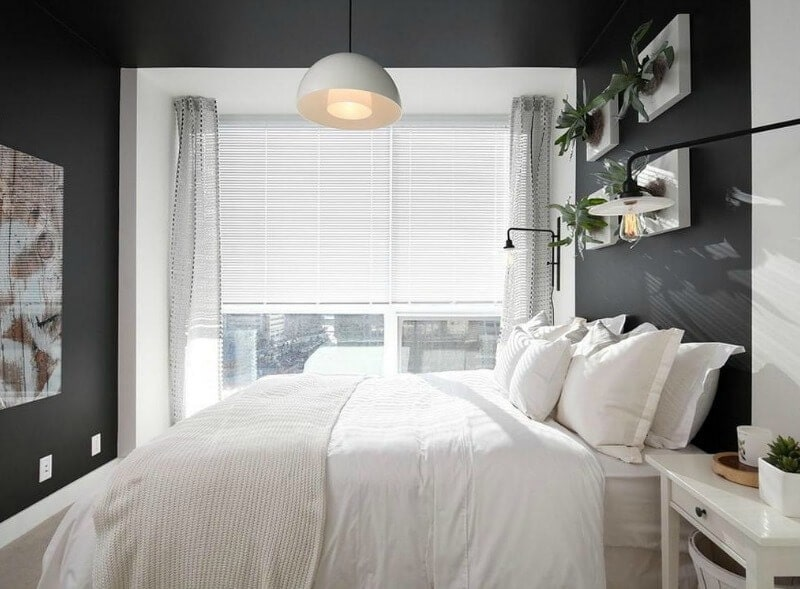 black walls in bedroom with white bedding and white window treatment