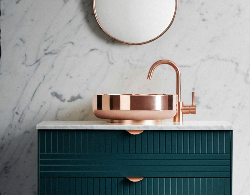 brass tapware and basin with green vanity powder room design