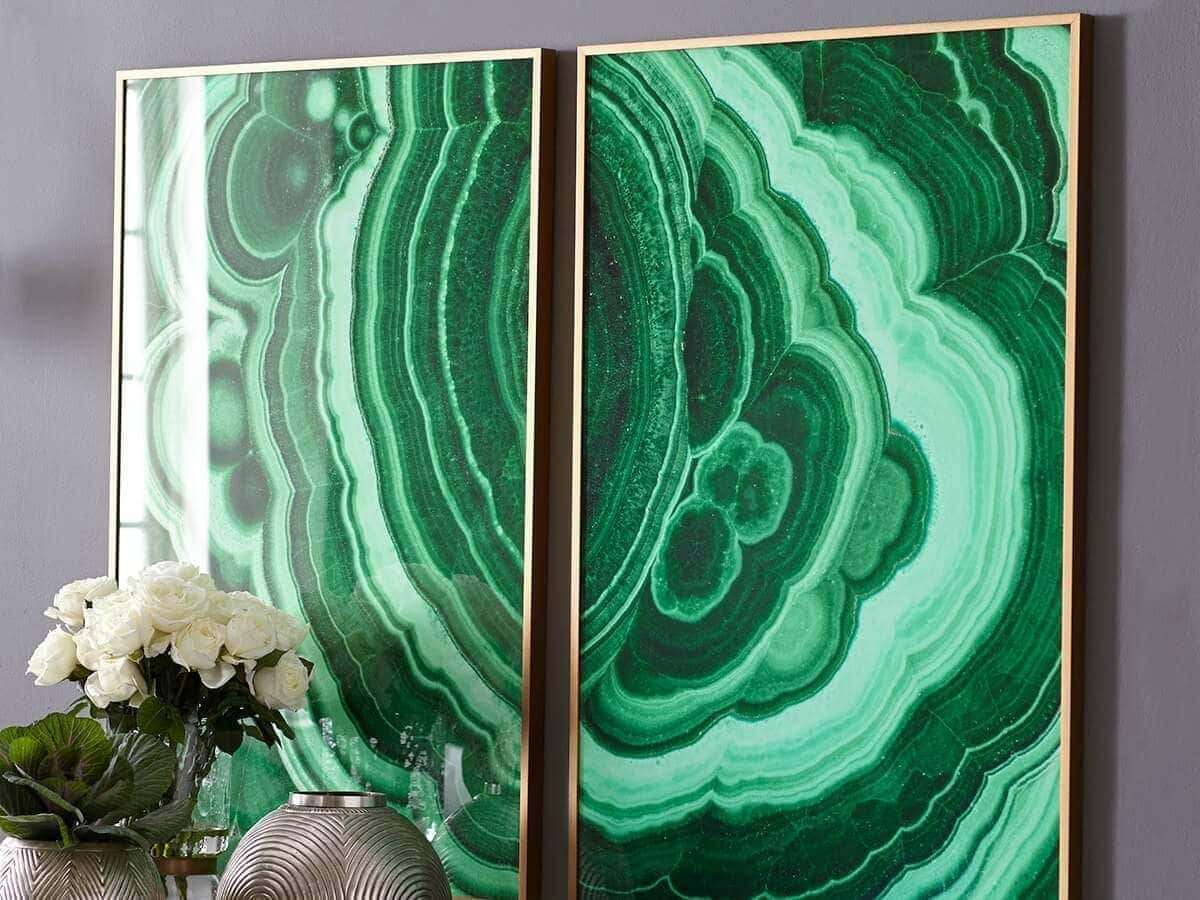 emerald green and brass artwork against dark grey feature wall