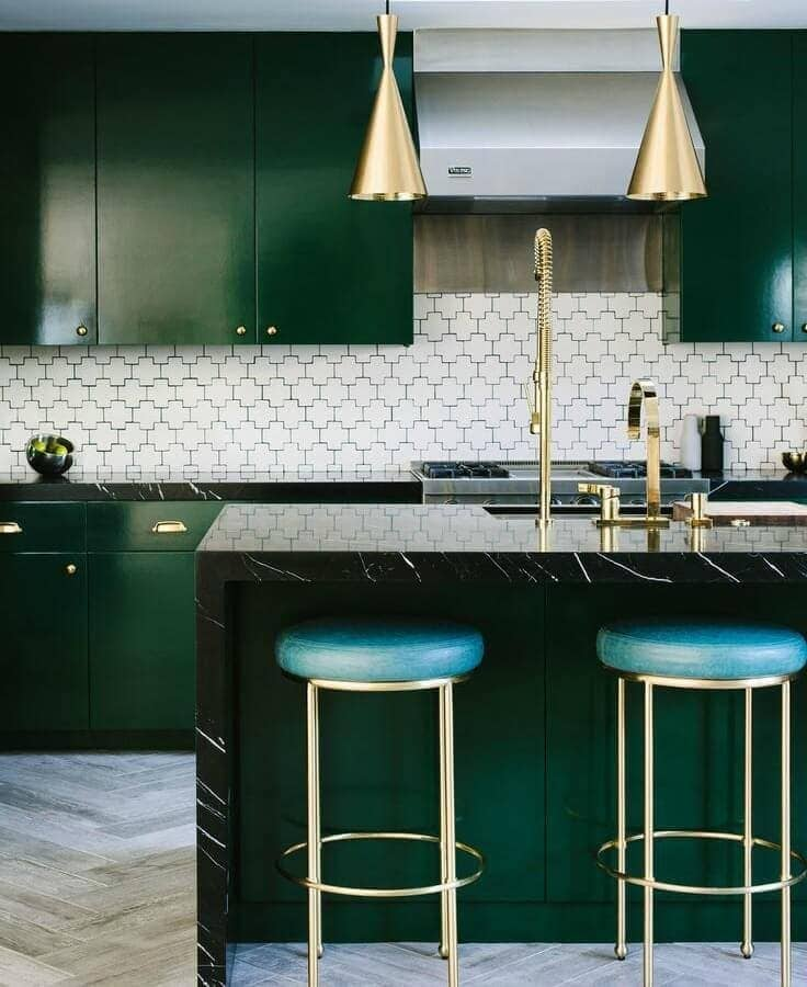 emerald green kitchen caninetry with brass handles and brass pendants