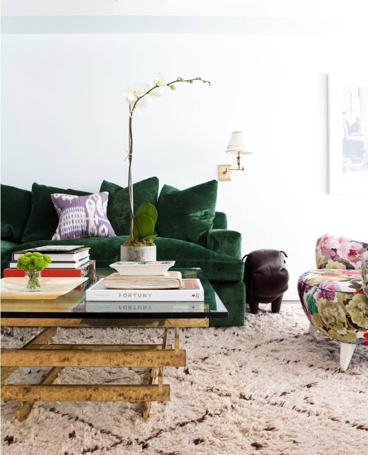 emerald green sofa with brass coffee table and shag rug