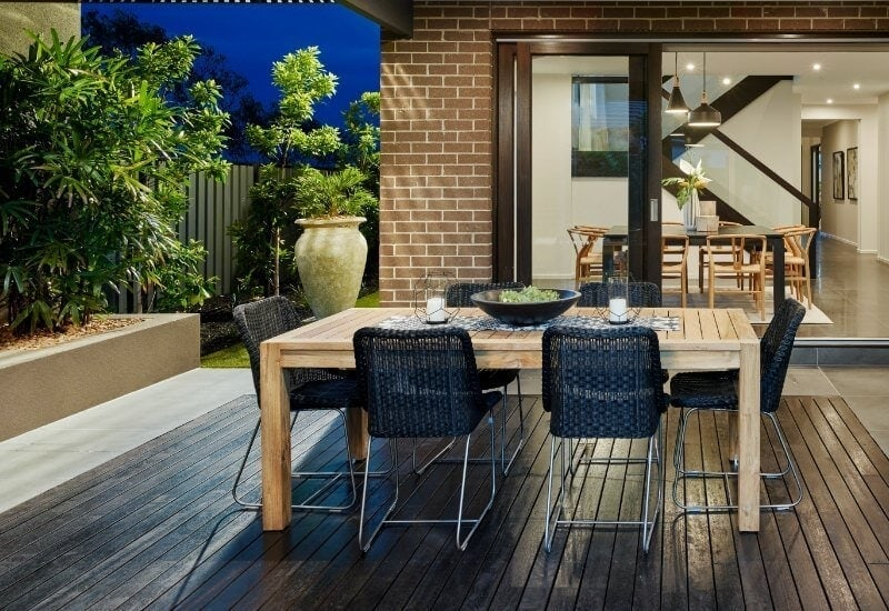 outdoor area with dark timber floor and garden by metricon