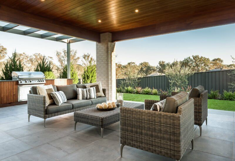 outdoor room with timber clad ceiling and built in bbq area by metricon