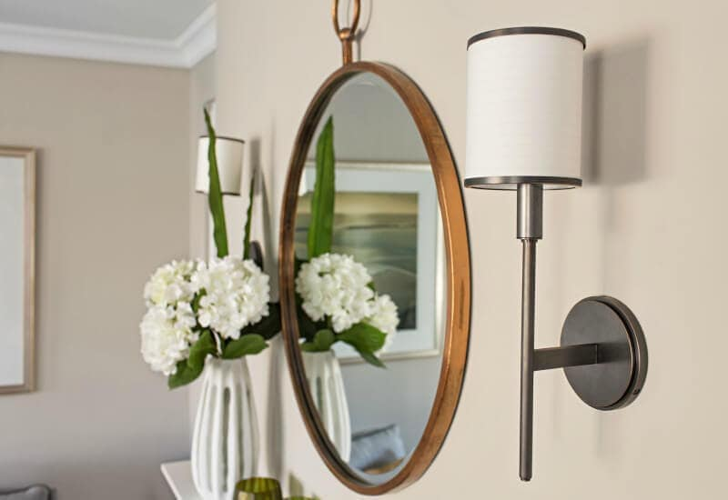 brass-round-mirror-and-wall-sconces-in-hamptons-style-home